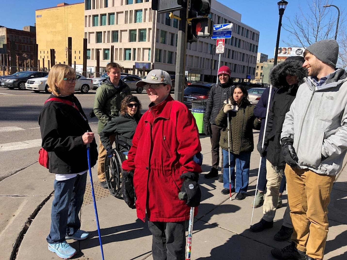 Members of the Inclusive Walk Audit Facilitator's Guide working group in Minnesota outside on a walk audit using assistive mobility devices.
