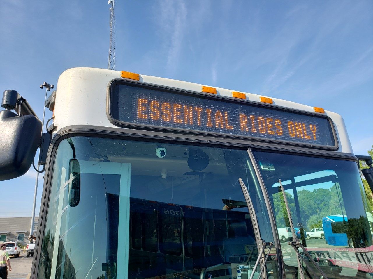 Parked bus has on their front LED sign, Essential Rides Only