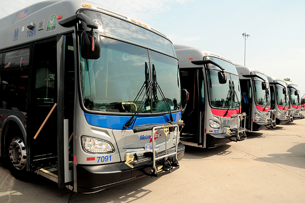 A fleet of WMATA buses are parked at a depot.